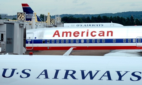 An American Airlines plane is seen between two US Airways planes at Washington's Ronald Reagan National Airport.