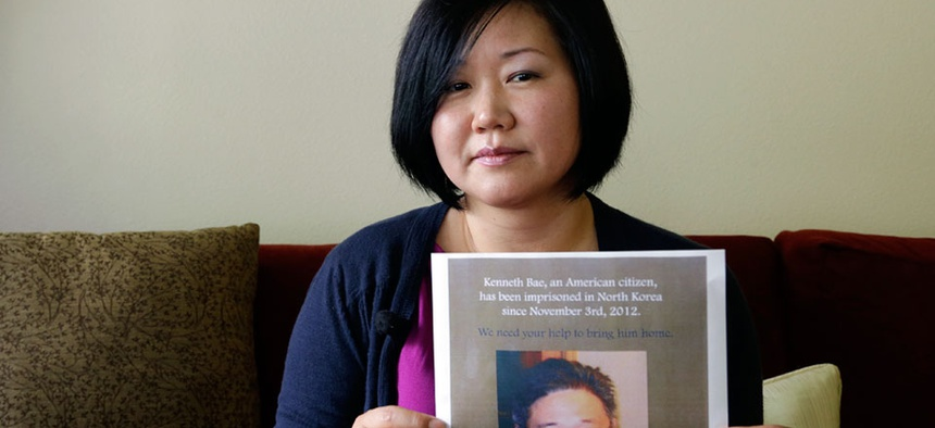 Terri Chung holds a notice of a prayer vigil for her brother, Kenneth Bae.