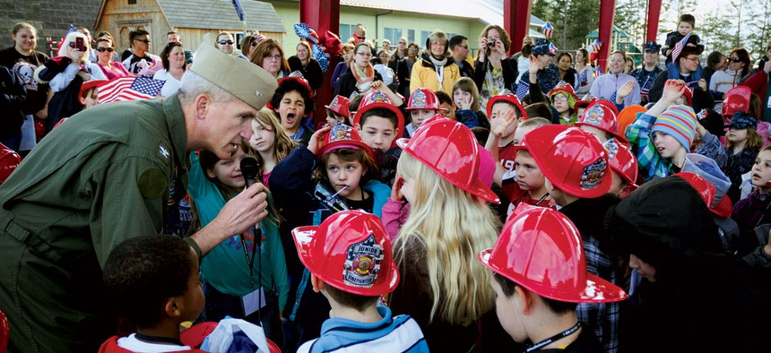 Capt. Christopher Phillips meets with children of active-duty sailors at a kids camp designed to show what deployment is like. Many in the military community say the challenges service members and their families face aren't well understood.