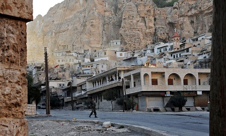 A Syrian government solider  in Maaloula in the midst of fighting in the village.