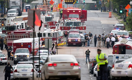 Emergency personnel respond to a reported shooting at the Washington Navy Yard.