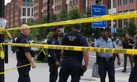 Police tape off a section of DC around the Navy Yard Monday.