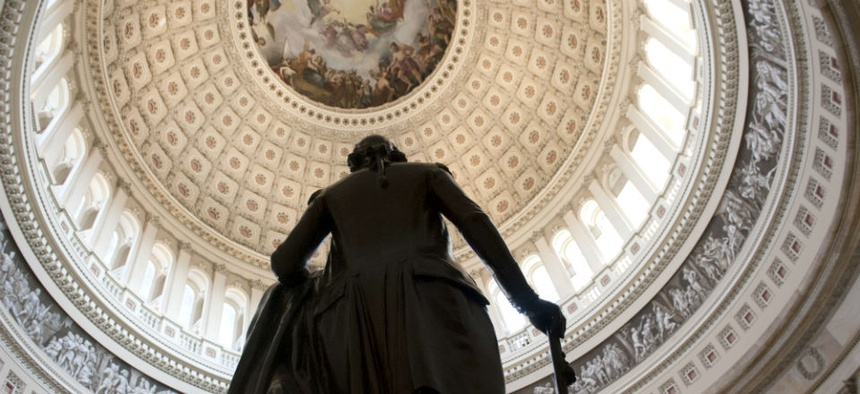 A statue of George Washington stands in the Rotunda of the U.S. Capitol Sunday morning, Sept. 29, 2013 as a government shutdown looms.