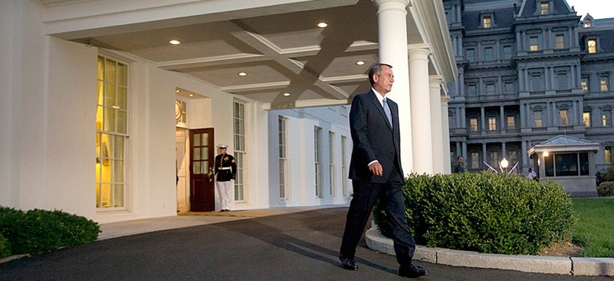 House Speaker John Boehner, R-Ohio, walks out of the West Wing of the White House after meeting with President Obama on Wednesday, Oct. 2, 2013.