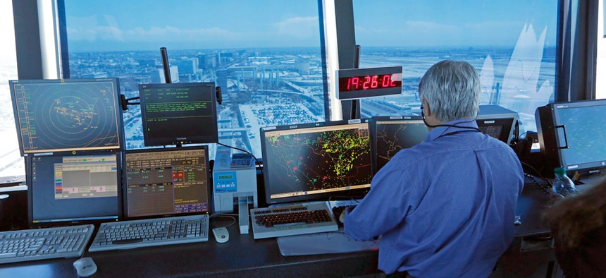 An air traffic controller works in the control tower at Los Angeles International Airport