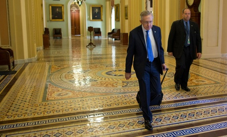 Harry Reid walks to his office Monday.
