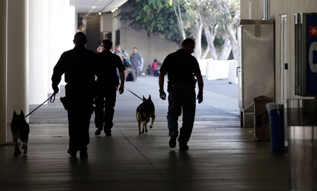 Police check the area around Terminal 1 at Los Angeles International Airport Friday.