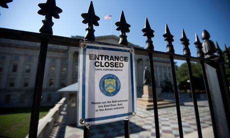 A sign outside of Treasury indicates the closure of one entrance due to the government shutdown Oct. 1.