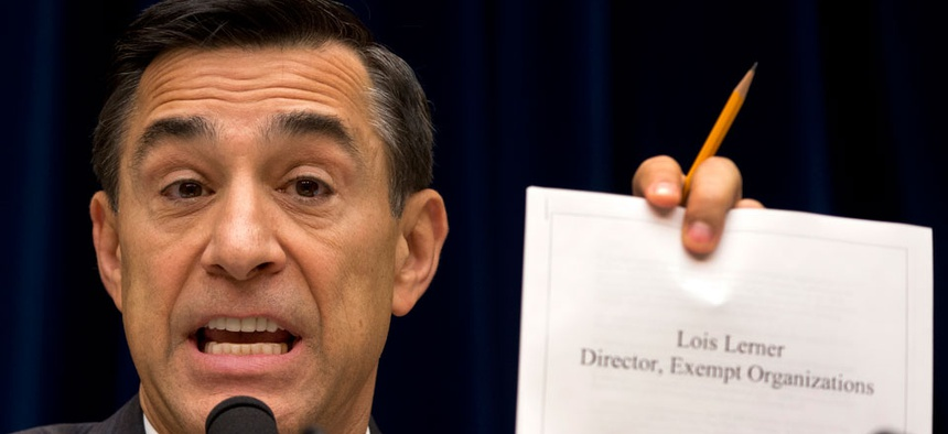 Rep. Darrell Issa, R-Calif.,  holds up documents during a hearing on the IRS in May.