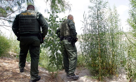 U.S. Customs and Border Patrol agents patrols along the Rio Grande in 2009.