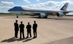 Secret Service agents watch as President Barack Obama leaves on Air Force One.