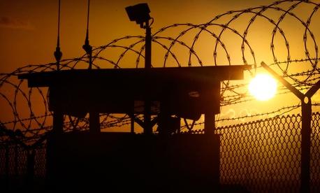 The sun rises above Camp Delta at Guantanamo Bay Naval Base, Cuba.