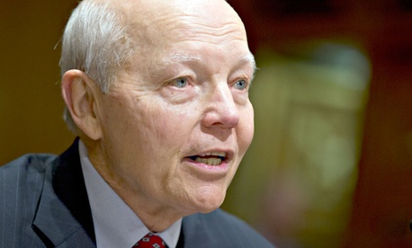 John Koskinen, President Barack Obama's choice to head the Internal Revenue Service testifies on Capitol Hill in Washington.