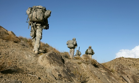 Soldiers patrol in the mountains near Sar Howza, Afghanistan in 2009.