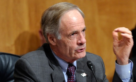 """In the aftermath, it is only natural that we wonder if all people entering a federal facility -- even employees -- should be screened in some way,"" said Sen. Tom Carper, D-Del."