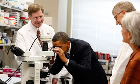 President Barack Obama tours an oncology laboratory with Health and Human Services Secretary Kathleen Sebelius at the National Institute of Health in Bethesda, Md.