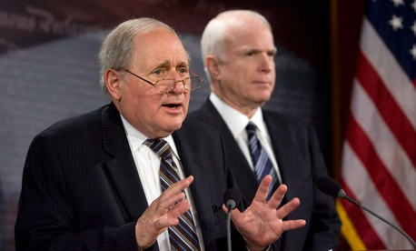 Senate Armed Services Committee Chairman Sen. Carl Levin, D-Mich., left, accompanied by Sen. John McCain, R-Ariz. ranking Republican on the committee.