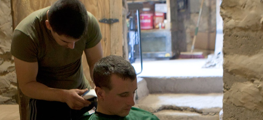A Marine gets his hair cut at Observation Post Athens, Helmand province, Afghanistan in November.