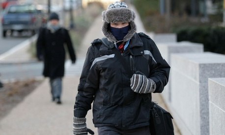 A pedestrian Tuesday on Constitution Avenue in Washington, where temperatures plunged to 3 degrees Fahrenheit.