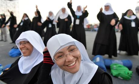 Nuns wait on Copacabana beach for Pope Francis' arrival in Rio de Janeiro, Brazil.