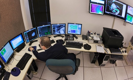 Science and operations officer Christopher Buonanno monitors data at the National Weather Service Warning and Forecast Office in North Little Rock, Ark.