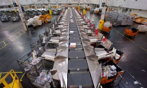 Parcels are automatically sorted at the United States Postal Service Leslie N. Shaw Sr. Processing and Distribution Center in Los Angeles.