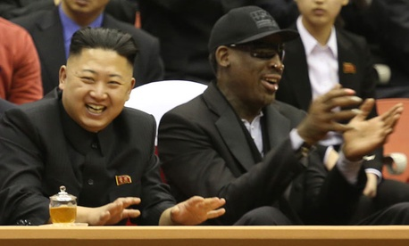 Rodman and Kim Jong-un watch a basketball game in North Korea in 2013.