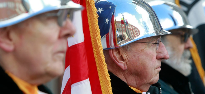 Thomas McGibney, center, serves in a color guard during a Veterans Day ceremony on Monday, Nov. 11, 2013 in Montpelier, Vt.