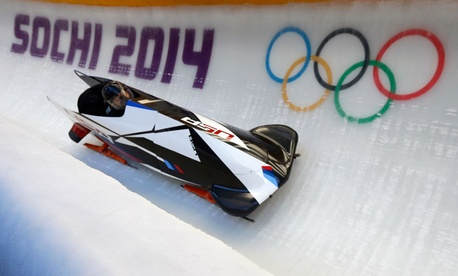 Steven Holcomb, a member of the Army's World Class Athlete Program, pilots one of the United States' bobsleds during an event in Sochi.