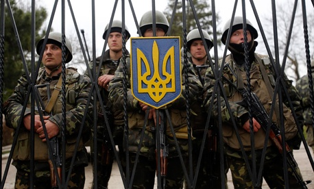 Ukrainian soldiers guard a gate of an infantry base in Privolnoye, Ukraine.