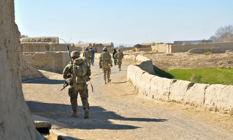 American soldiers conduct a partnership patrol with members of the Afghan Uniformed Police in Kandahar in December.