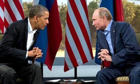President Barack Obama speaking with Russian President Vladimir Putin in Enniskillen, Northern Ireland, Monday, June 17, 2013.