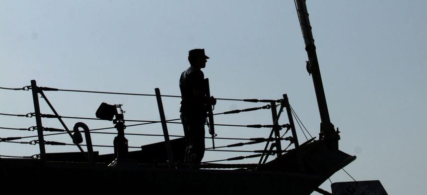 A U.S. Navy sailor is seen aboard the destroyer USS Kidd.