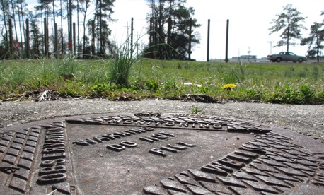 A manhole cover sits at the site of the Hadnot Point Well No. 602 at Camp Lejeune, N.C., in 2013