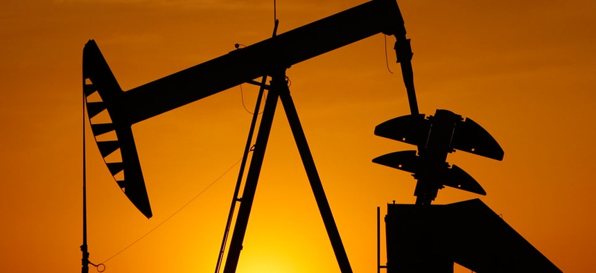 A pumpjack is silhouetted against the setting sun in Oklahoma City.