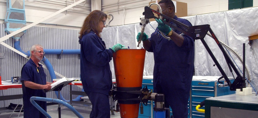Technicians perform maintenance on W-76 nuclear warhead.