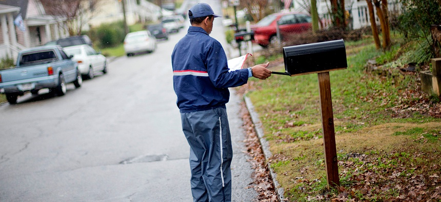 A postal worker delivers mail in Atlanta in 2013.