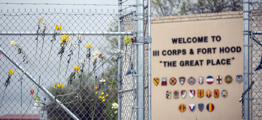 Flowers decorate a fence outside of Fort Hood's east gate on Sunday, April 6, 2014, in Killeen, Texas, in honor of those killed and wounded in the Fort Hood shooting on April 2.