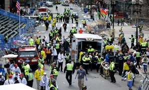 Medical workers aid injured people near the finish line of the 2013 Boston Marathon following two bomb explosions in 2013.