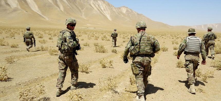 Soldiers patrol near Kunduz, Afghanistan in 2013.