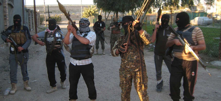 Anti-government gunmen hold their weapons as they patrol in Fallujah last month.