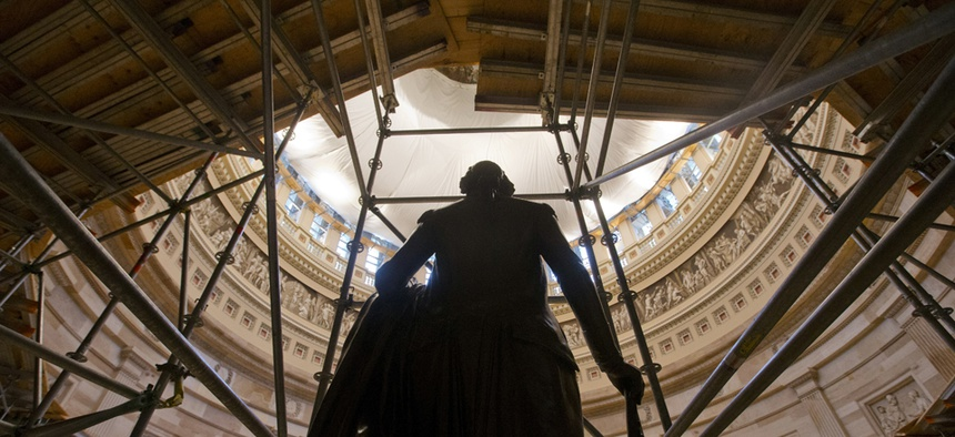 The statue of George Washington is seen surround by scaffolding after safety netting was installed around the inside the Capitol Rotunda.