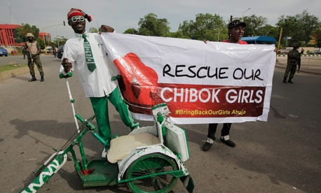 A man attends a demonstration in Abuja, Nigeria Tuesday.