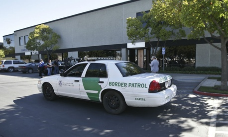 A Border Patrol vehicle drives in San Diego, CA