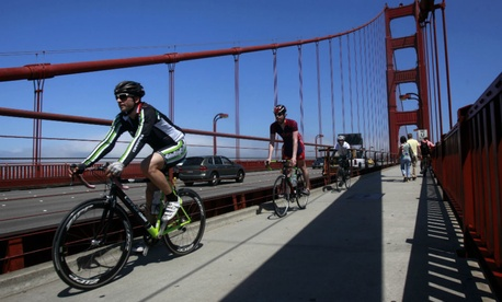Bicycilists drive south as they cross the Golden Gate Bridge on Bike To Work Day in San Francisco.