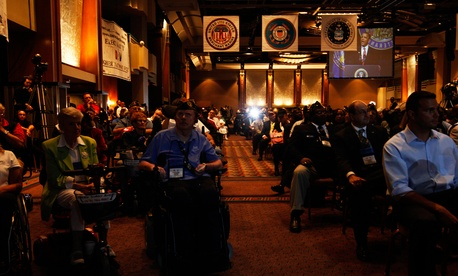 Audience members listen as President Barack Obama speaks about Iraq and Afghanistan at the Disabled American Veterans national convention in Atlanta in 2010.