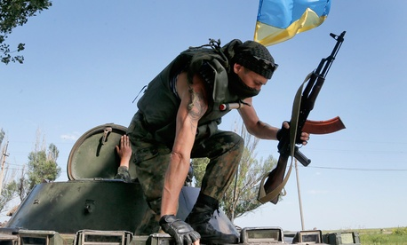 Ukrainian soldiers take position during a battle with pro-Russian separatist fighters outside Slovyansk on Thursday.