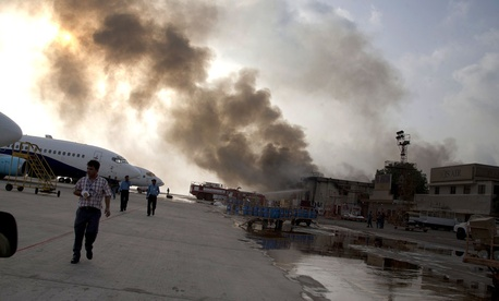 Smoke rises above the Jinnah International Airport where security forces battled militants in Karachi, Pakistan.