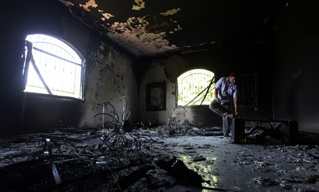 A Libyan man looks around the burnt U.S. Consulate in Benghazi in 2012.