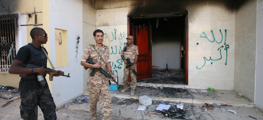 Libyan military guards check one of the U.S. Consulate's burnt out buildings in September 2012.
